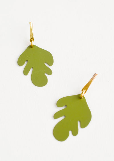 Metal earrings with green cutout leaf shape and brass bar post