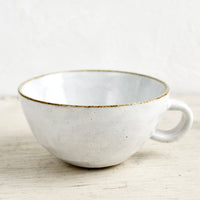 Glossy White / Latte Mug: A ceramic latte mug in a glossy white glaze with soft speckles.