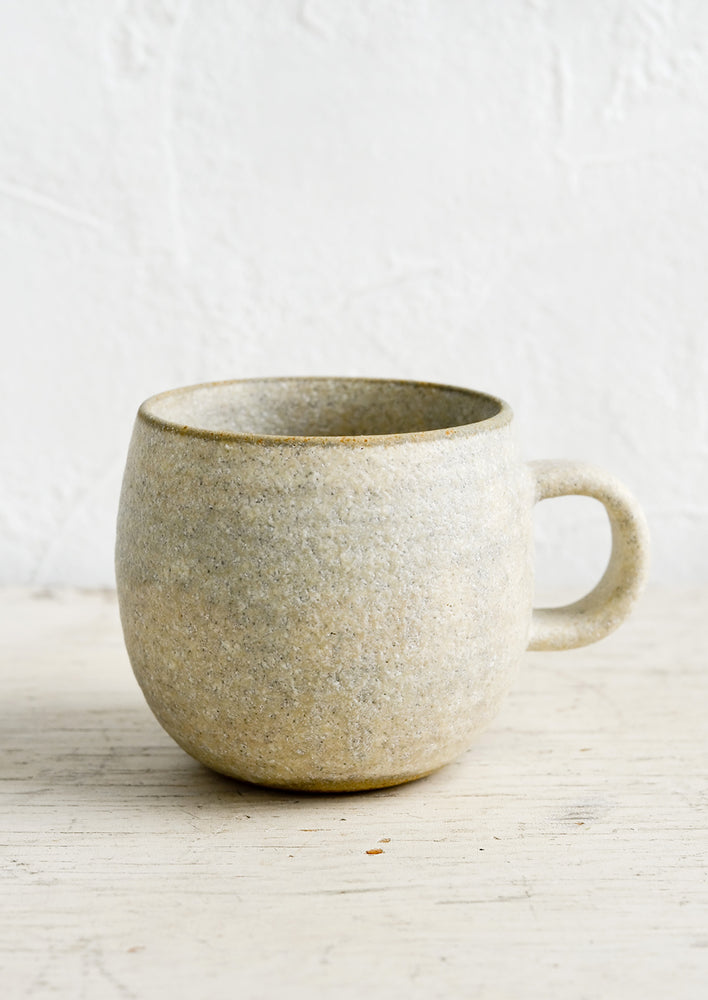 Matte Grey / Standard Mug: A ceramic coffee mug in a rustic, textured sandy glaze.