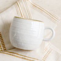 Glossy White / Standard Mug: A round coffee mug in softly speckled glossy white glaze.