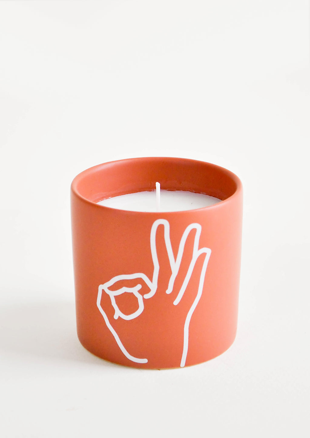 "It's Ok: Scented candles in colored ceramic jar with ""it's ok"" hand symbol"