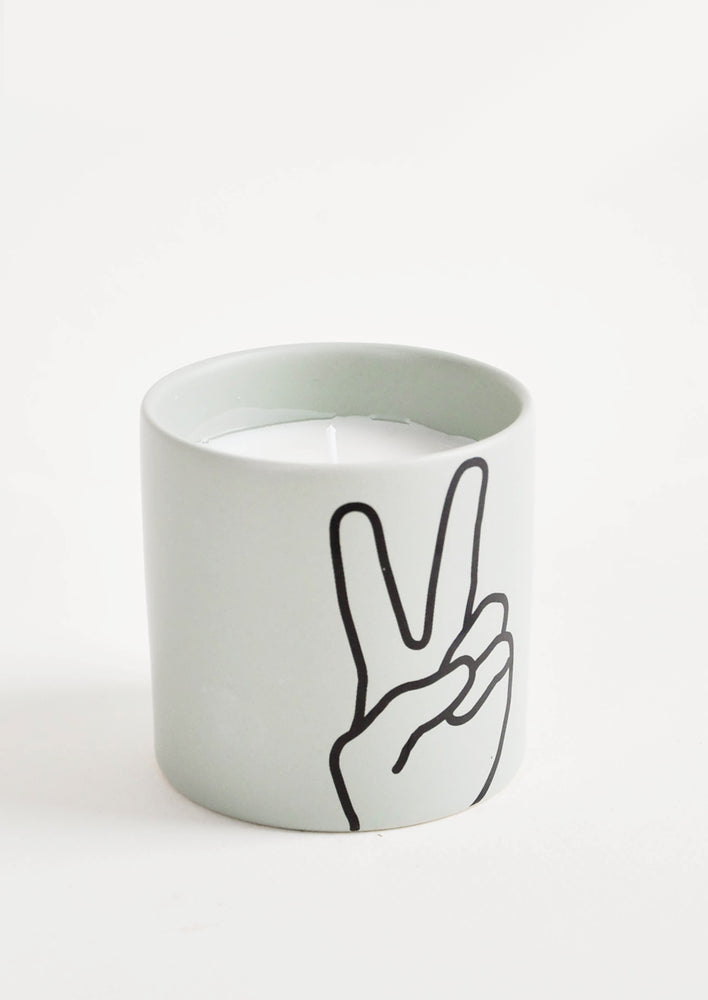 "Peace: Scented candles in colored ceramic jar with ""peace"" hand symbol"