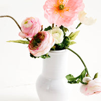 2: Glossy white ceramic vase with wide bottom and tapered top, with floral arrangement