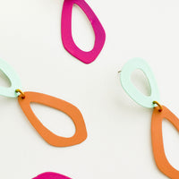 4: Two pairs of two toned figure eight earrings.