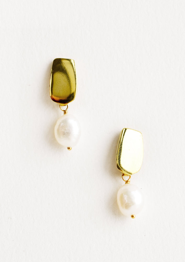 Brass: Earrings with a rectangular gold post and small pearl drop.