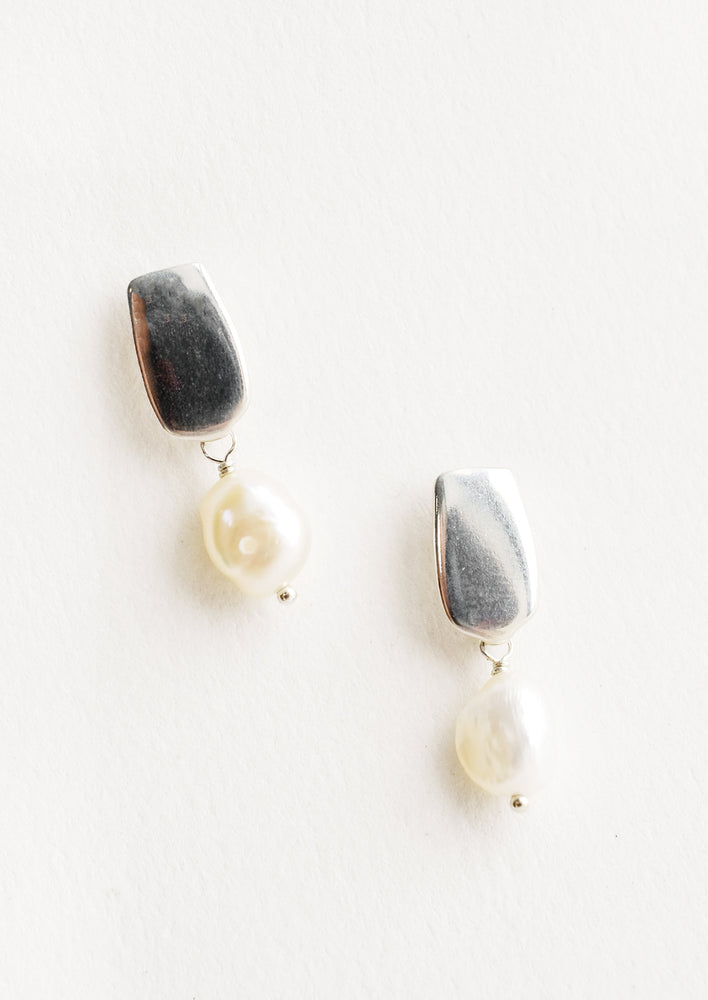 Sterling Silver: Earrings with a rectangular silver post and small pearl drop.