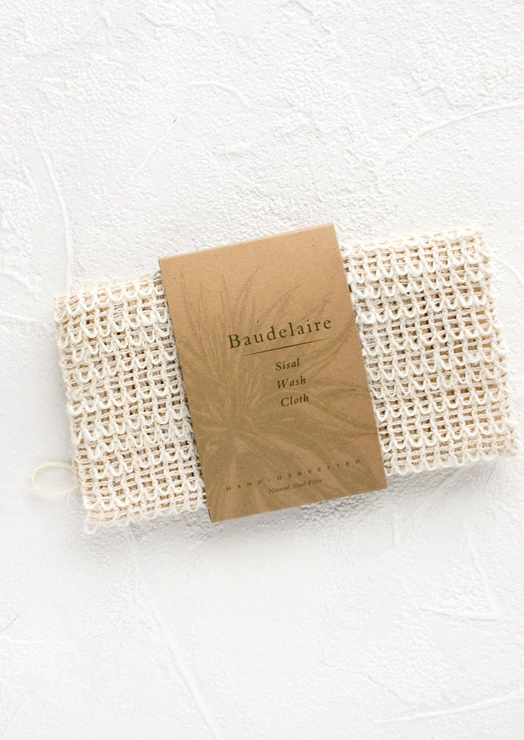 1: Natural sisal washcloth folded in its packaging