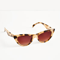 1: Cat eye sunglasses with tortoiseshell frame and tinted lenses.