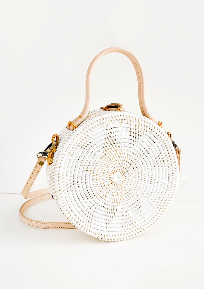 Round, canteen-style handbag woven in white rattan with tonal flower pattern and natural leather accents