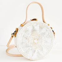 1: Round, canteen-style handbag woven in white rattan with tonal flower pattern and natural leather accents