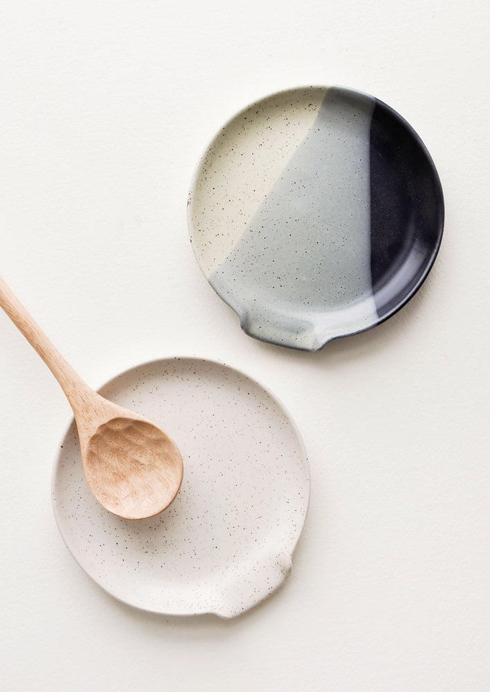 1: Circular ceramic spoon rests in varied artisan glazes, shown with wooden spoon