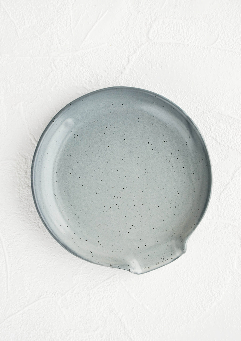 Grey: Circular ceramic spoon rest in grey with tiny black speckles