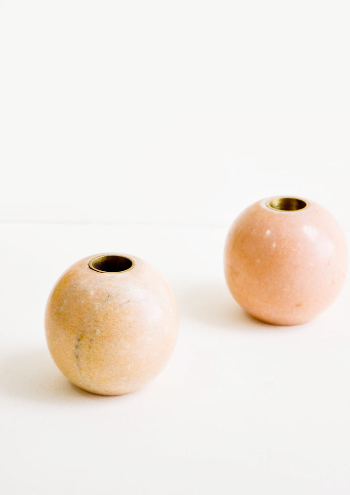 Sphere: Sphere shaped taper candle holders in pink marble with brass inlay