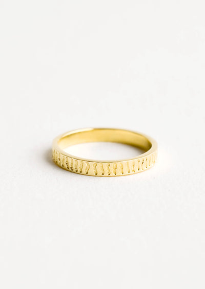 Gold band ring with squiggly lines etched all around