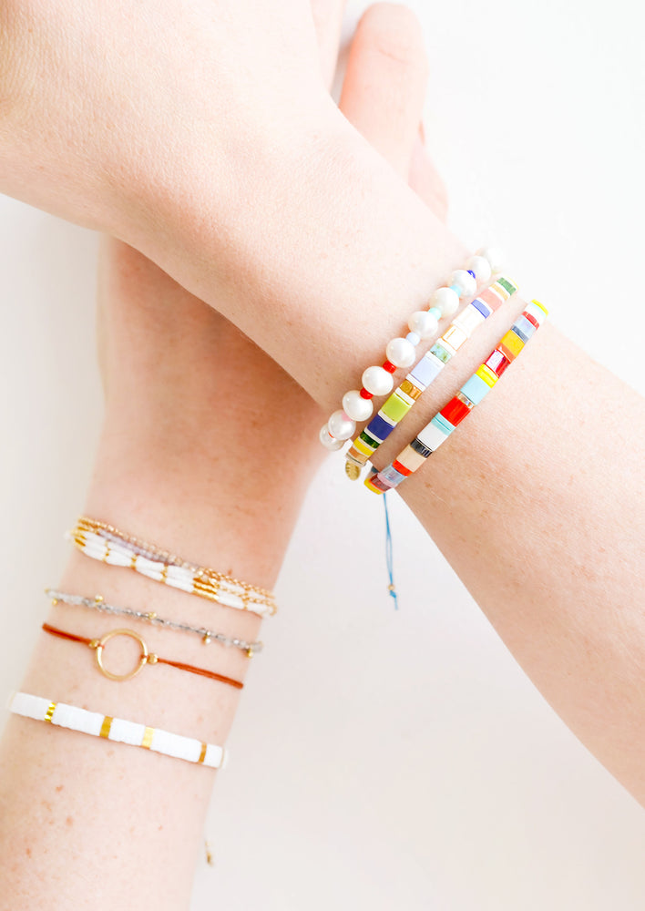 8: Model shot showing wrists wearing multiple styles of bracelets.