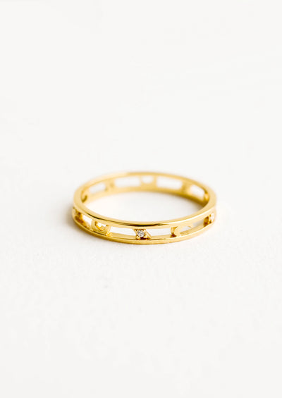 Golden ring with open middle panel featuring crescent moons and crystals