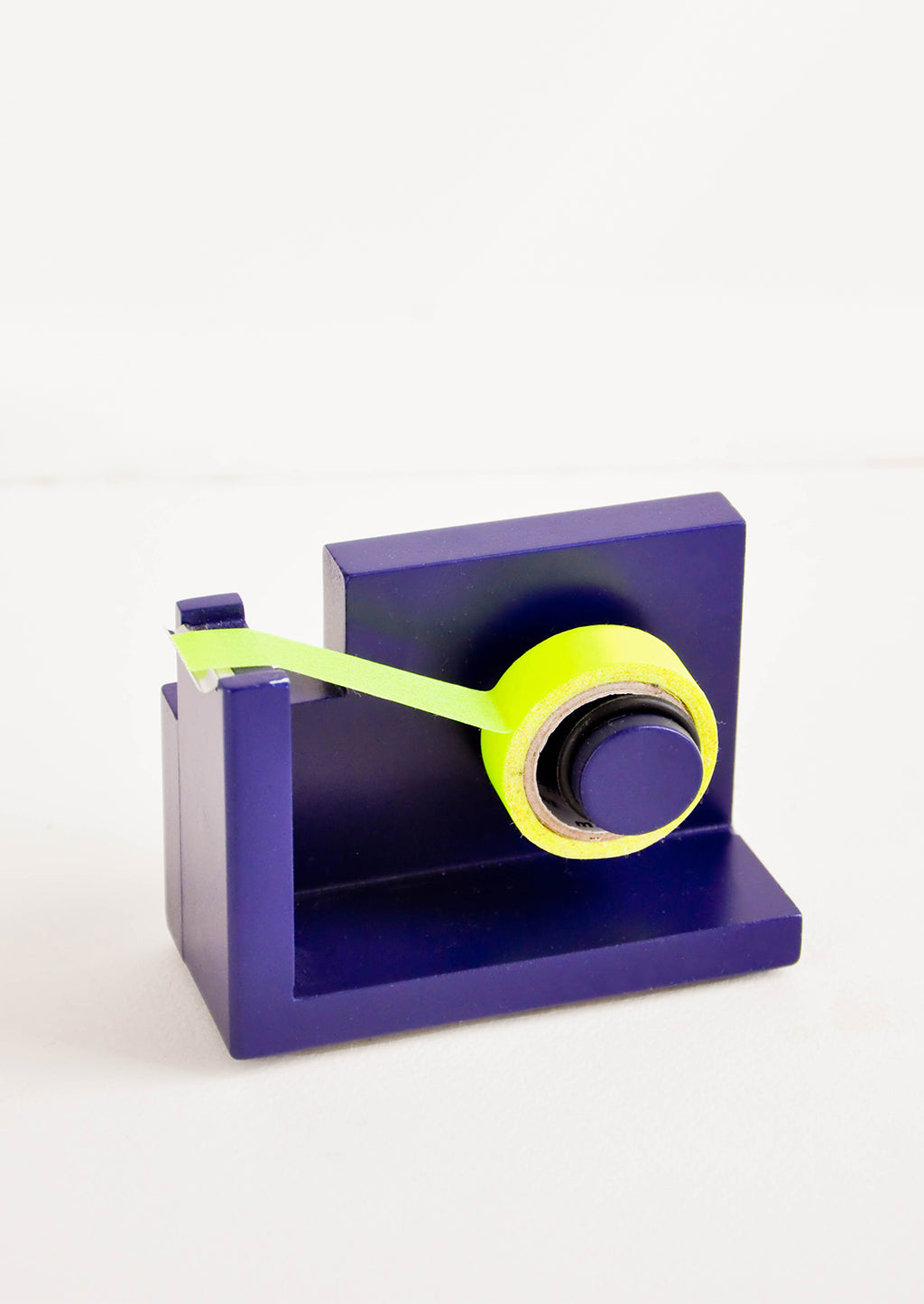 Navy: Navy blue wooden tape dispenser with yellow tape.