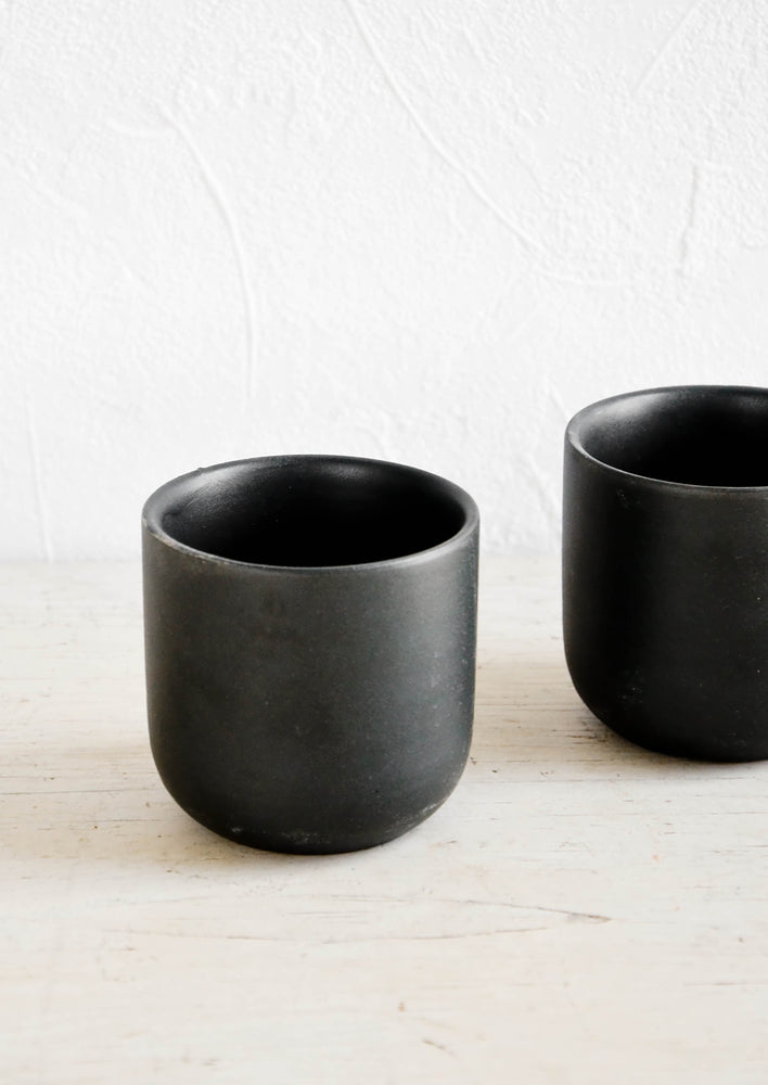1: Short rounded cups in matte finished black ceramic