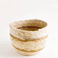 Small [$35.00]: Small, round storage basket woven from natural maize fiber with tan stripes