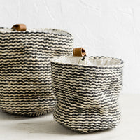 2: Small and large baskets in striped jute.