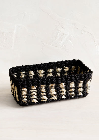 A structured rectangular storage basket in black with tan dashes.