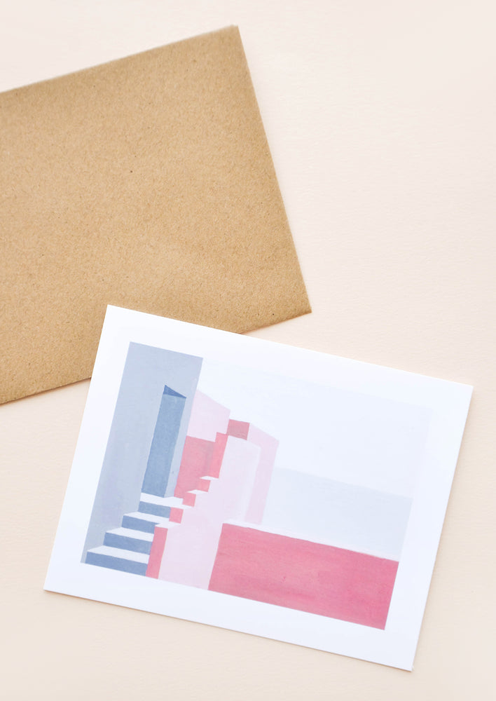 1: Greeting card with blue and pink stucco step illustration. Shown with brown craft paper envelope.