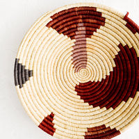 2: Shallow woven raffia bowl with abstract pattern in lavender, wine and charcoal