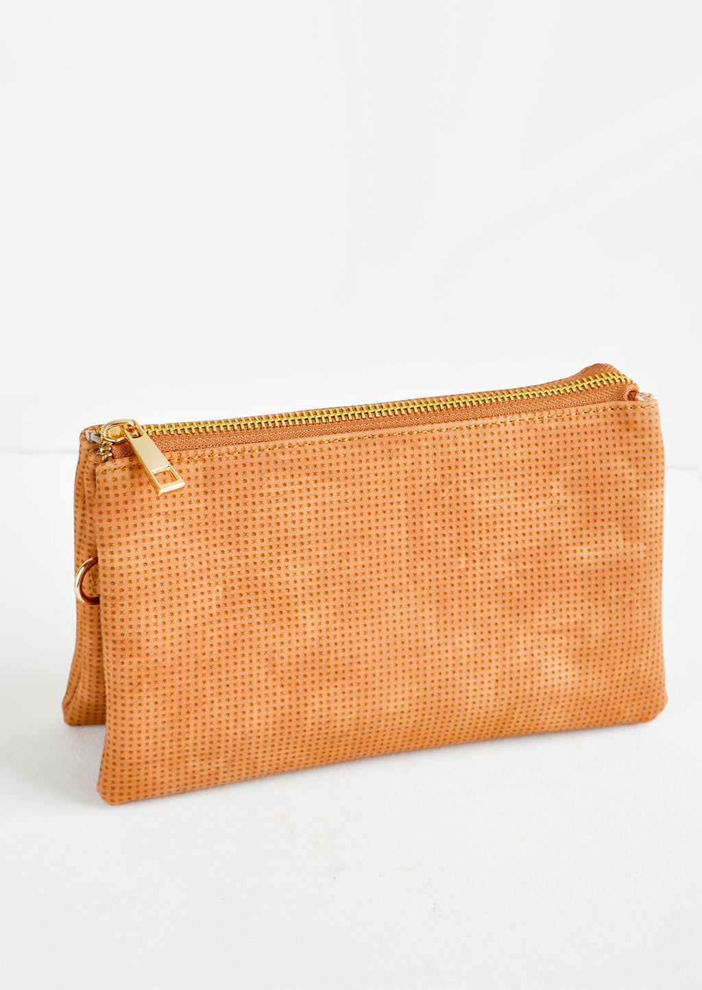 Caramel Perforated: Orange fabric clutch purse featuring two attached pouches with gold zipper.