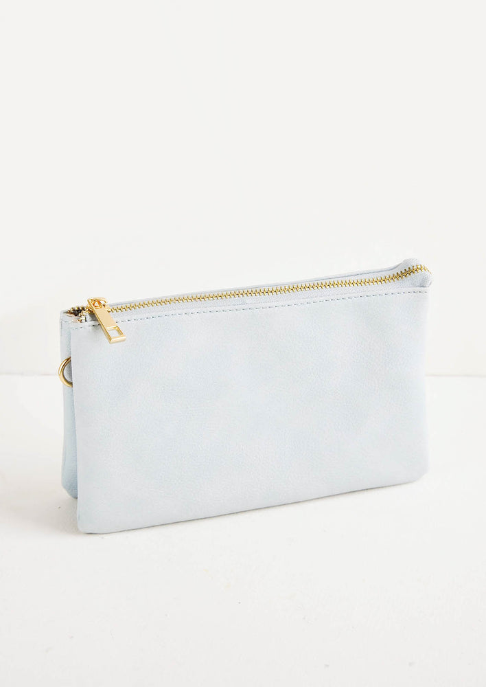 Glacier Pebbled: Pebbled light grey fabric clutch purse featuring two attached pouches with gold zipper.