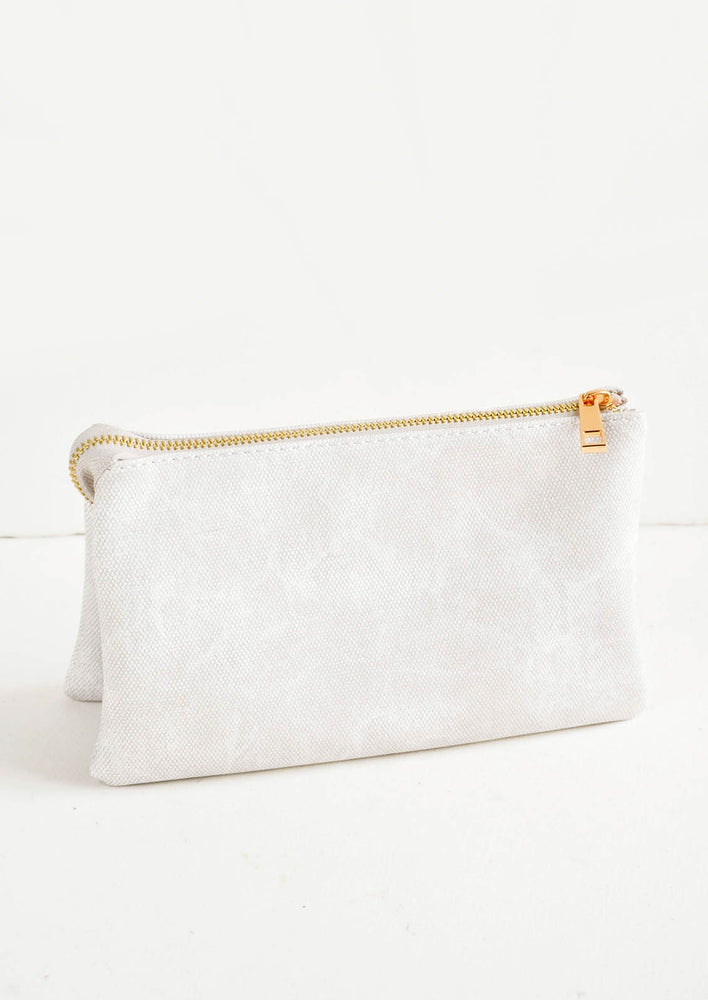 Light grey fabric clutch purse featuring two attached pouches with gold zipper.