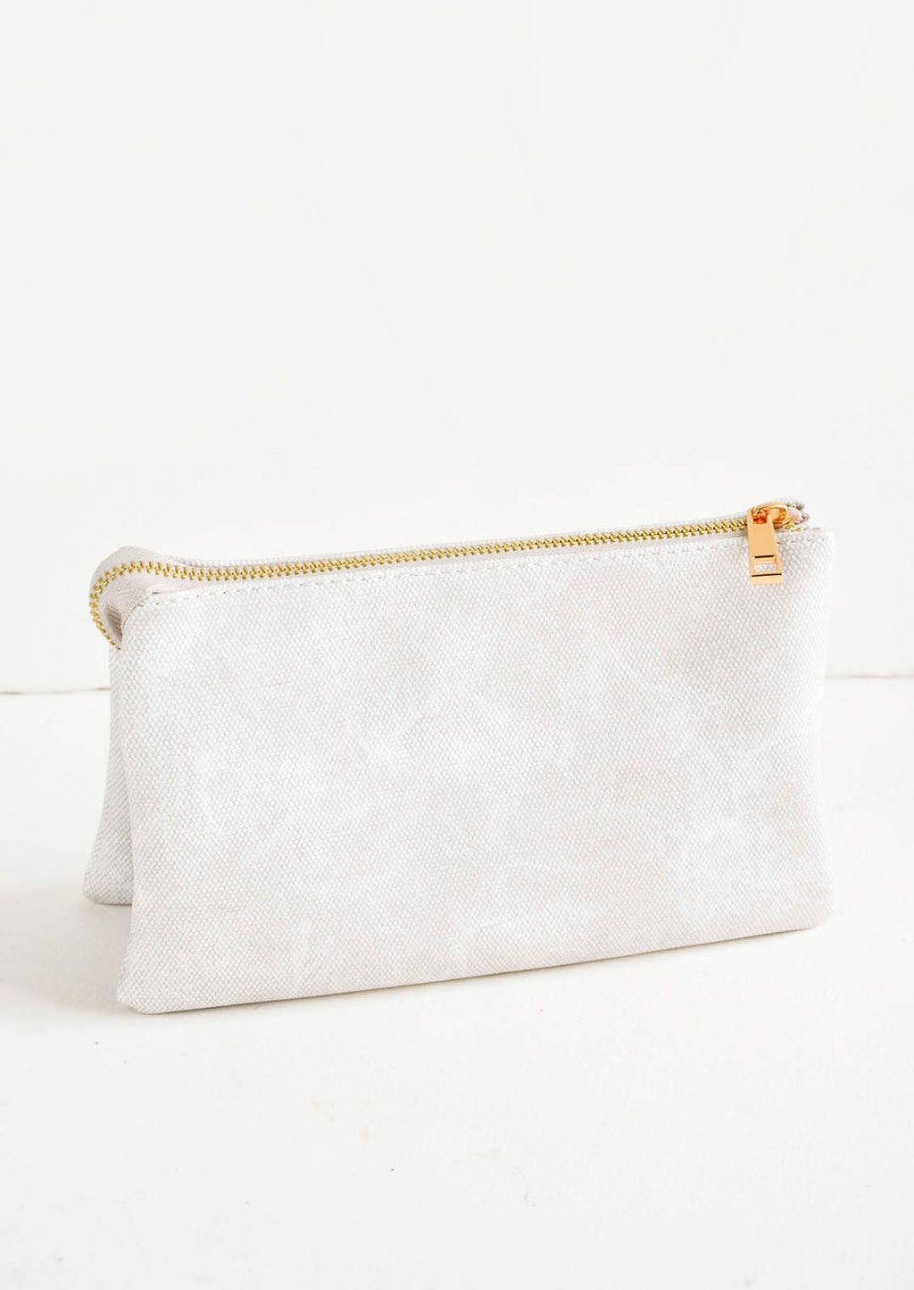 Distressed Grey Canvas: Light grey fabric clutch purse featuring two attached pouches with gold zipper.