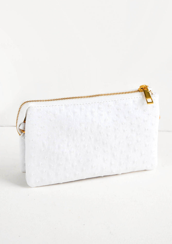 White Ostrich: Textured white fabric clutch purse featuring two attached pouches with gold zipper.