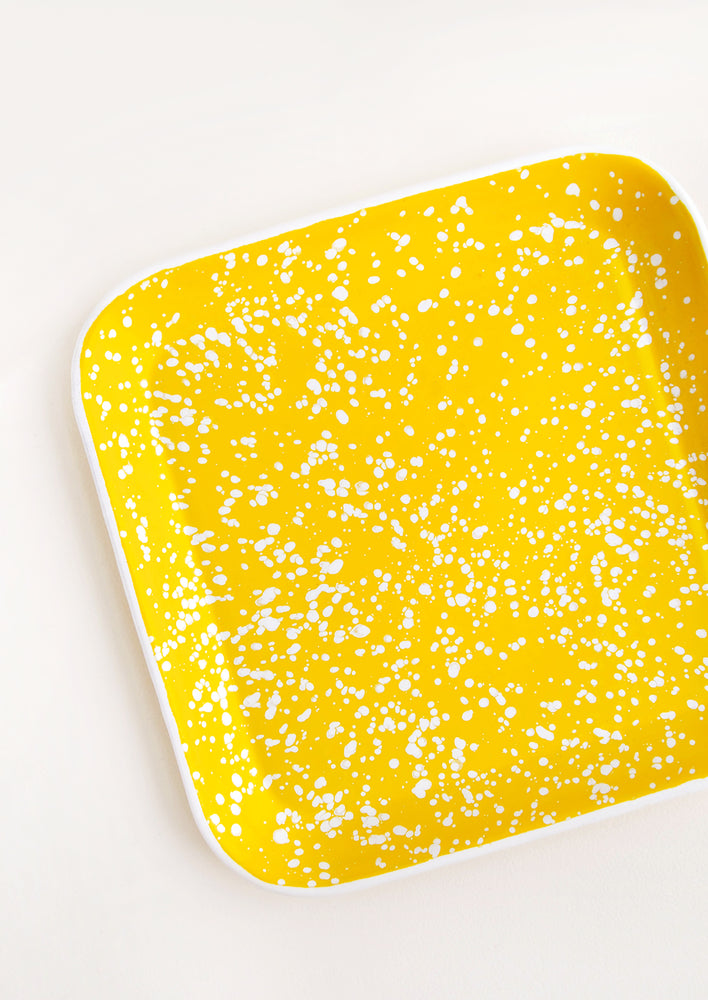 1: Square Enamel Tray in Yellow with Allover White Splatter Pattern and raised edges.