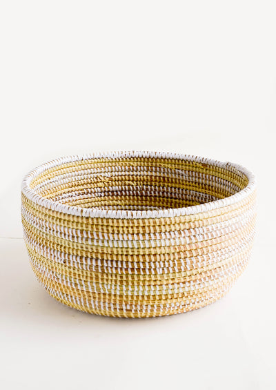 Woven storage basket made from grass with two-tone stripes made from recycled plastic