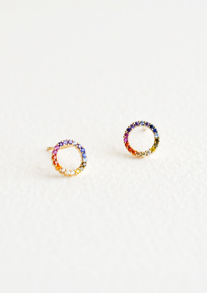 1: Stud earrings in open circle shape with colored rainbow crystals around.