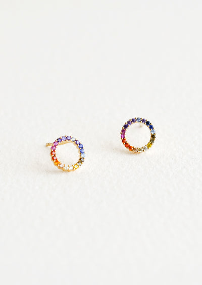 Stud earrings in open circle shape with colored rainbow crystals around.