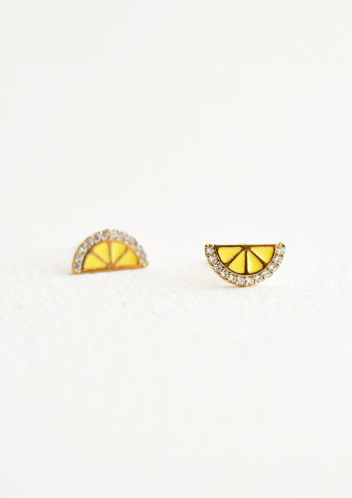 "Stud earrings in the shape of a lemon wedge with crystal ""rind""."
