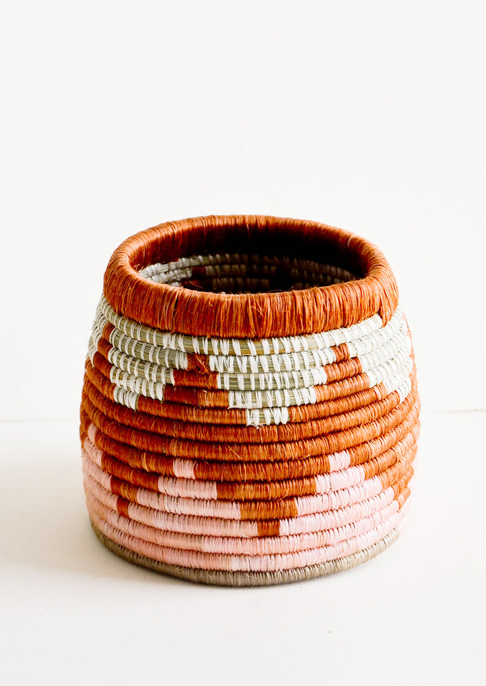 1: Woven sweetgrass basket with open top, in chevron pattern in pink and terracotta