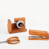 2: Product shot showing teakwood tape dispenser, scissors and stapler.