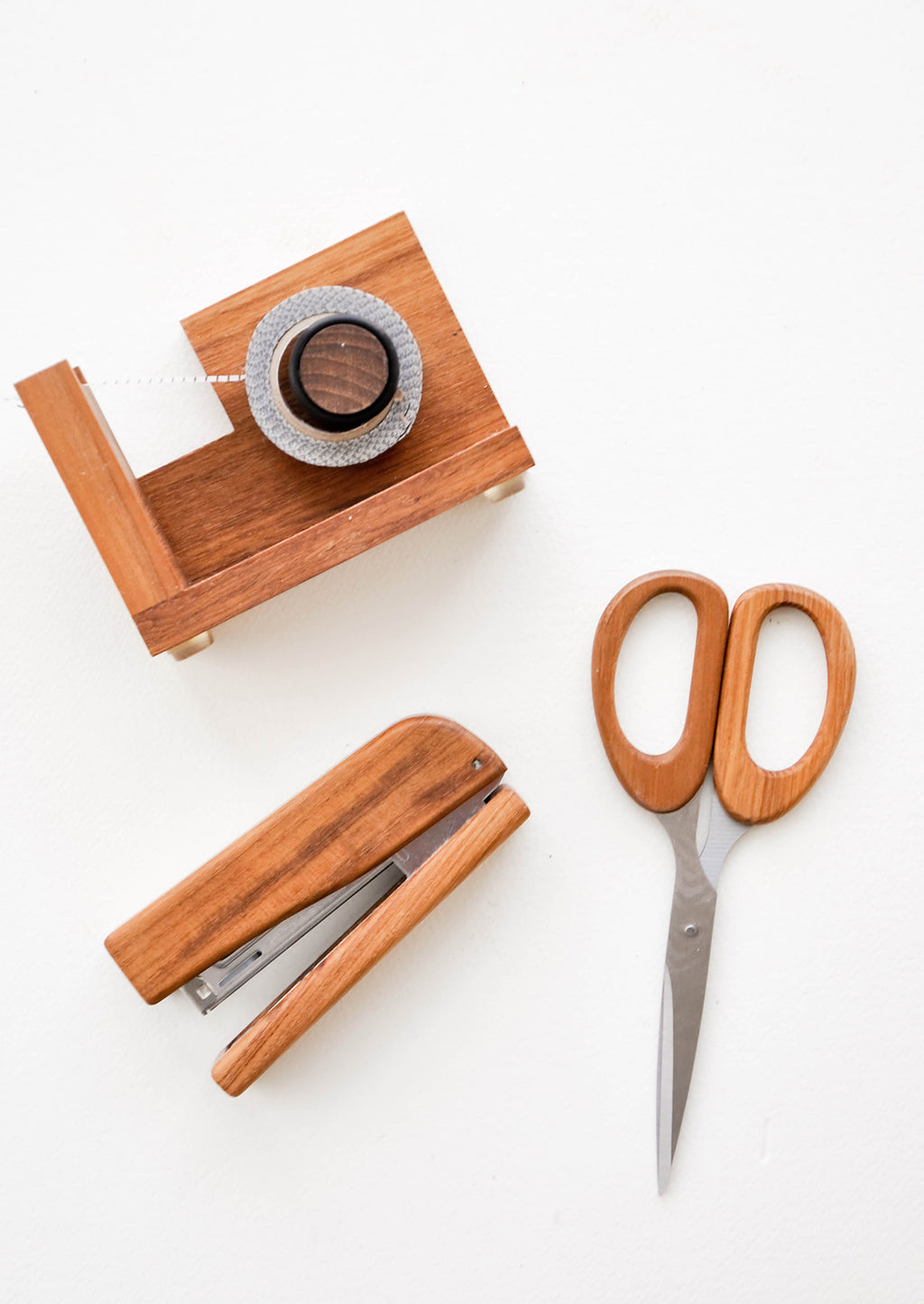 1: Product shot showing teakwood tape dispenser, scissors and stapler.