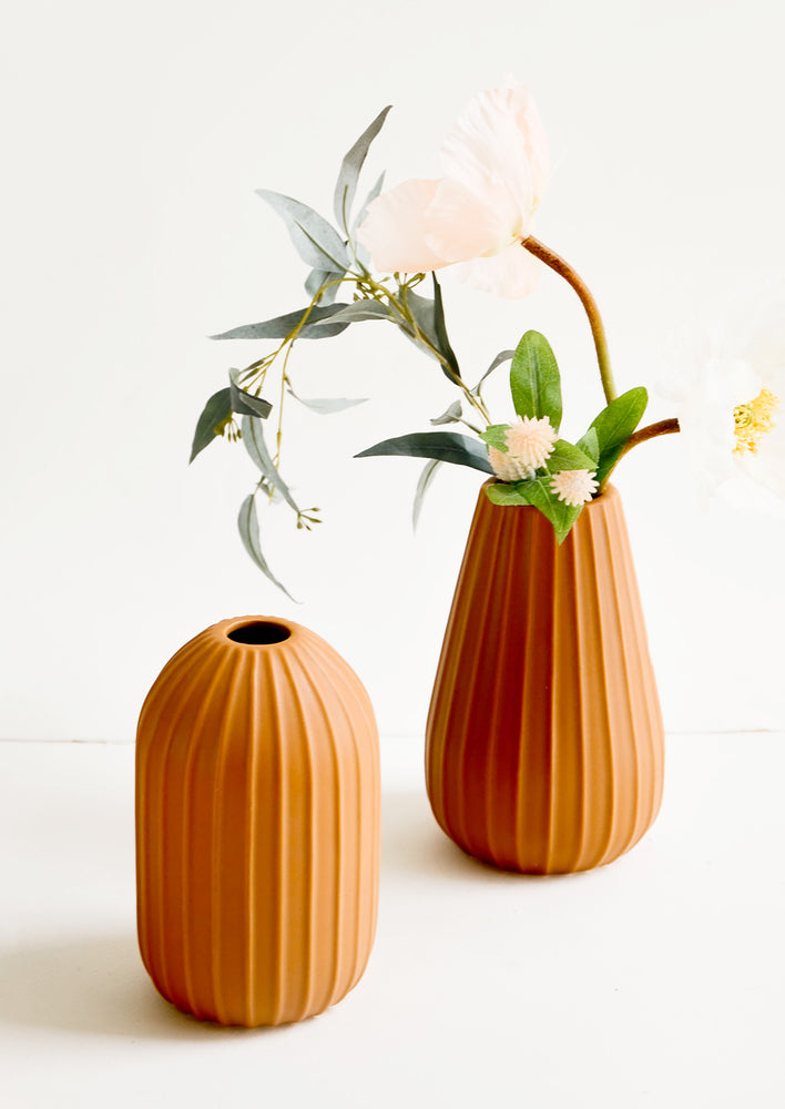 1: Terracotta colored ceramic vases with vertical ribbed texture