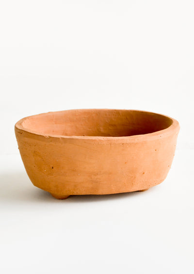 An oval shaped, deep terracotta vessel intended for use as a soap dish.
