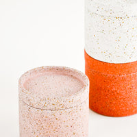 2: Stack of Colored Concrete Storage Jars with Speckled Glass Flecks