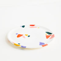 Warm Colors: Small, plate-like ceramic dish in ivory with hand-painted, fragmented pattern in a mix of colors