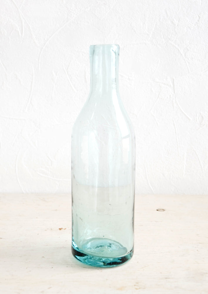 Clear: Wine-bottle shaped glass bottle in clear recycled glass