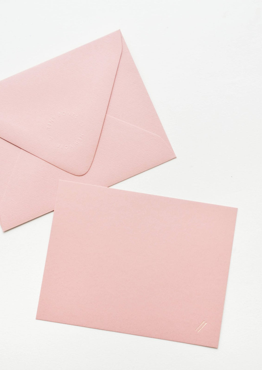 Single Card: A pink envelope and pink greeting card with two small gold foil diagonal lines at bottom right.