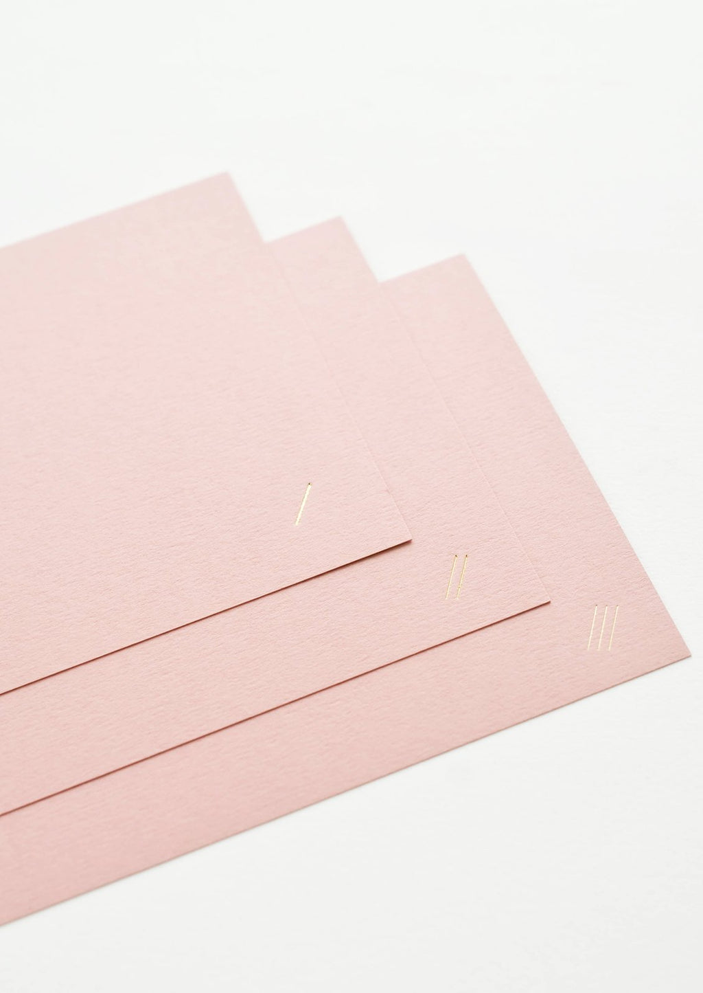 2: Three plain pink greeting cards.