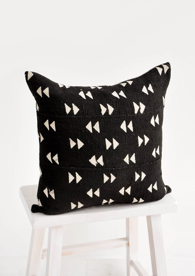 Square throw pillow in black mudcloth with allover tan triangle pattern