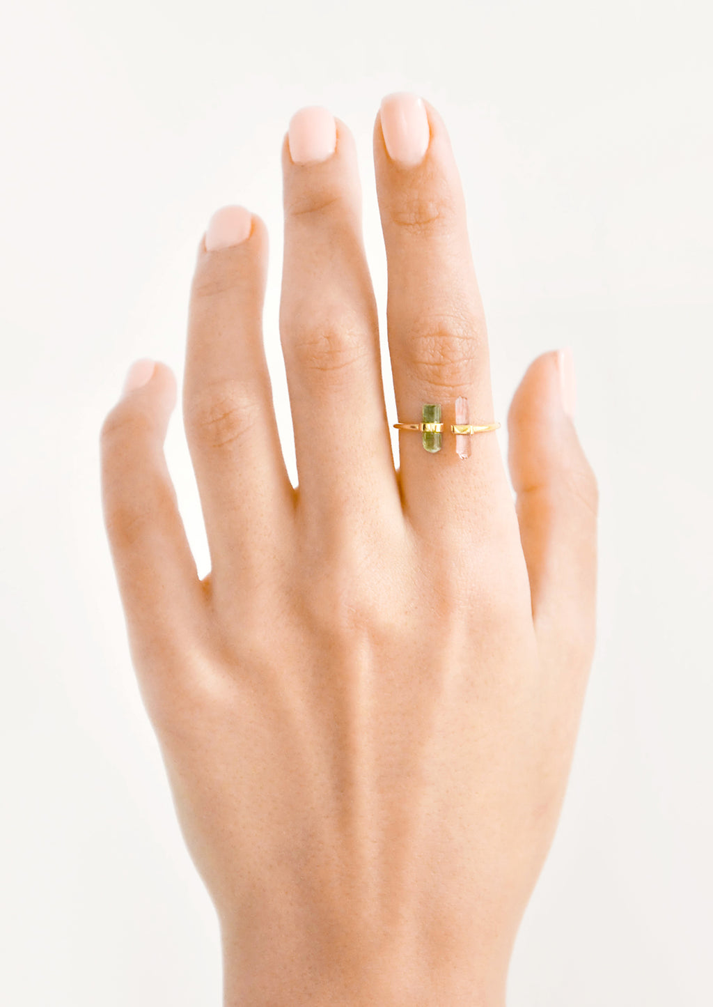 2: Model shot showing hand wearing ring with crystals.