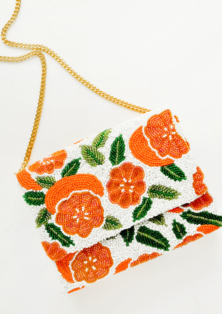 2: Beaded box-shaped clutch with orange citrus print and gold chain shoulder strap